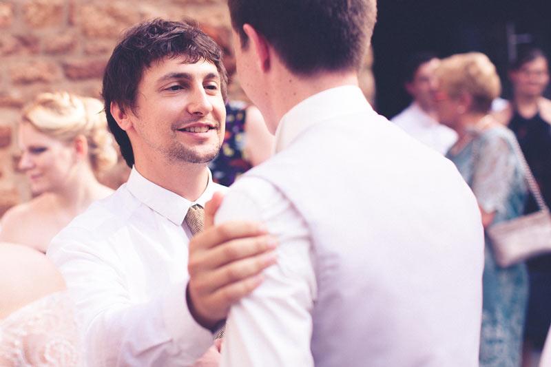 bestman congratulates groom