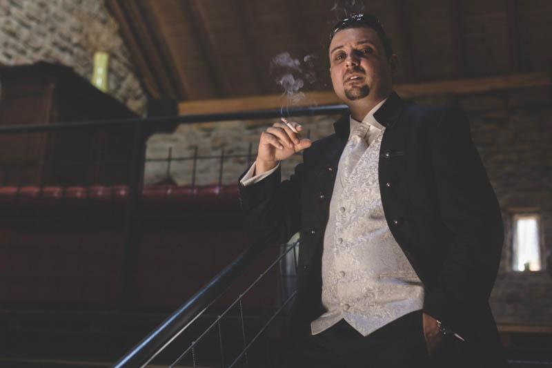 groom smoking a fag and posing like the godfather