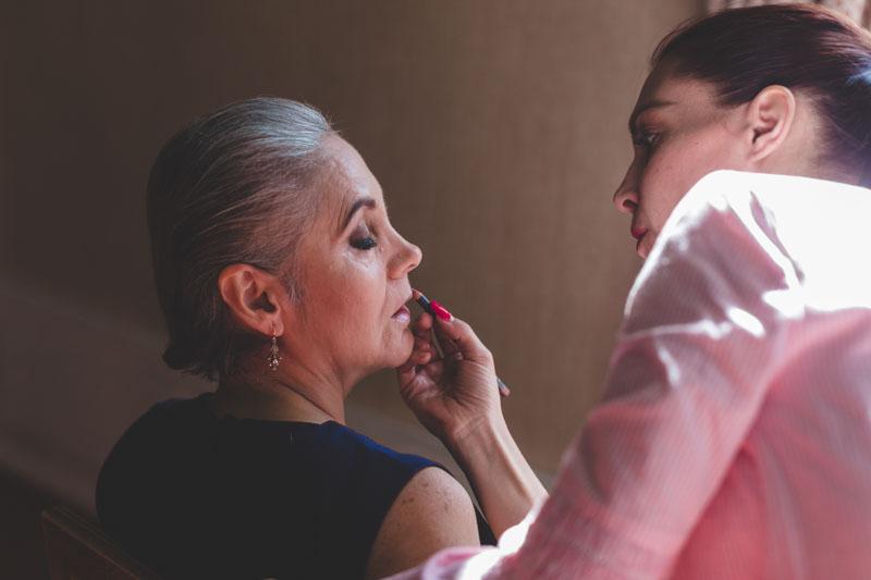 bride's mom doing makeup