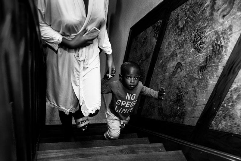 little boy climbs up stairs