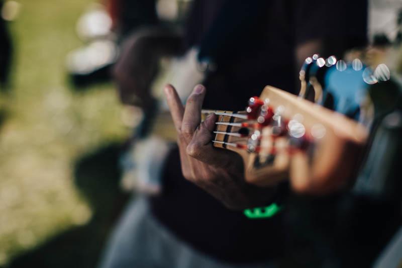 playing bass guitar at wedding