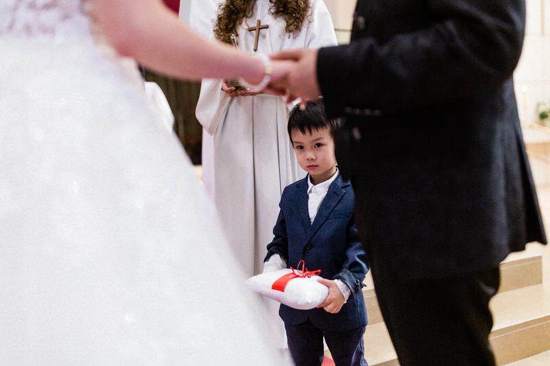 boy bringing wedding rings